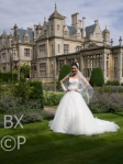 Chimgee in her magnificent wedding dress out side Stoke Rochford Hall